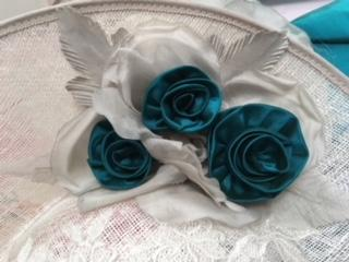 Thai silk roses made for hat to match bolero made to measure in same silk for mother of the groom.