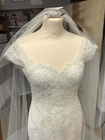 Dress taken in and shortened. Lace trim from veil used to make cap sleeves