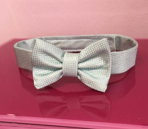Baby son's bow tie made to match groom's