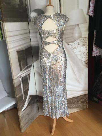 Vintage sequined dress taken in and shortened, then panel added to conceal bra.
